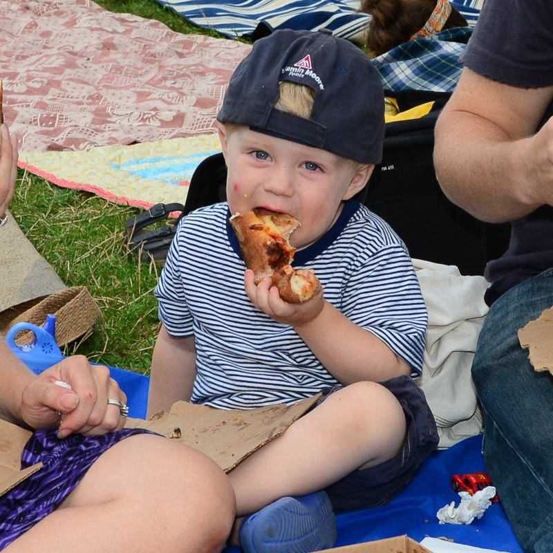 A child eating a pizza